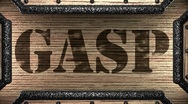 Gasp on wooden stamp Stock Footage