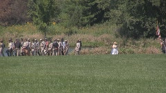 Stock Footage - Confederate infantry marching past pond - met by lady Stock Footage