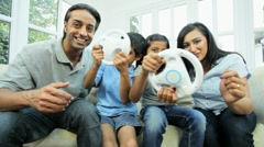Young Ethnic Children Playing on Home Games Console - stock footage