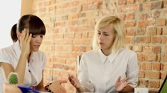 Two businesswomen in office stressful because of paperwork, steadicam shot - stock footage