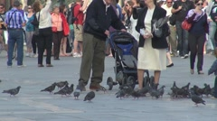 Men with pigeons in Piazza San Marco in Venice, Italy Stock Footage
