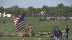 Stock Footage Med closeup - flags and troops on battlefield - stock footage