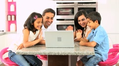Asian Family Using Laptop for Online Video Chat Stock Footage