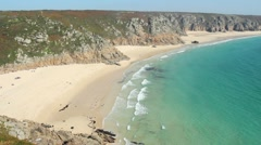 Porthcurno and Pedn Vounder beach low spring tide. Stock Footage