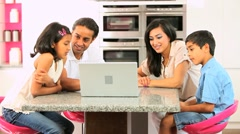 Young Ethnic Family with Laptop in Kitchen Stock Footage
