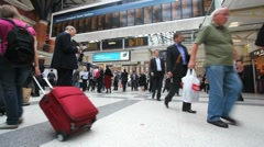 Train travelers in London railway station Stock Footage