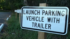 """Launch parking vehicle with trailer"" sign Stock Footage"