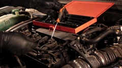 Auto mechanic repairing a part of a car engine Stock Footage