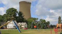 Power plant spews smoke as it overlooks a playground in Michigan City Stock Footage