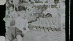 CHILD COMMUTERS Kiddie Car Ride Fun Fair 1940s Vintage Film 8mm Home Movie 768 Stock Footage