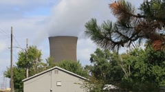 Coal burning Power Plant in a suburban setting Stock Footage