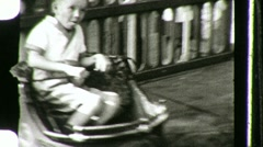 BOY Vintage Kiddie Car CARNIVAL AMUSEMENT PARK Ride 1940s Vintage Home Movie 769 Stock Footage