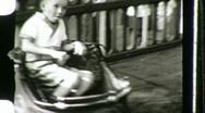 Stock Video Footage of BOY Vintage Kiddie Car CARNIVAL AMUSEMENT PARK Ride 1940s Vintage Home Movie 769