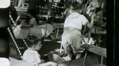 Vintage Kiddie Ride Circa 1945 (Vintage 8mm Home Movie Footage) 770 Stock Footage