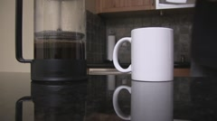 French press coffee pouring into mug. - stock footage