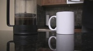 Stock Video Footage of French press coffee pouring into mug.