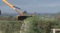 Tractor mounted hedge trimmer at work. Stock Footage