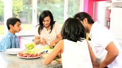 Ethnic Family in Kitchen Preparing Lunch Stock Footage