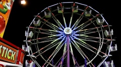 Interesting perspective of a ferris wheel ride Stock Footage