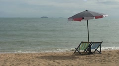 Inviting Chairs And Umbrella On Beach In Thailand Stock Footage