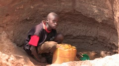 Kenya: Collecting Water from a Sand Pit Stock Footage