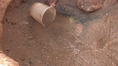 Kenya: Scooping Water from Sand Pit Stock Footage