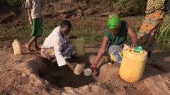 Stock Video Footage of Kenya: Water from Sand During the Drought