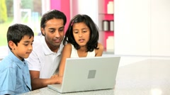 Young Asian Father & Children Using Laptop Stock Footage