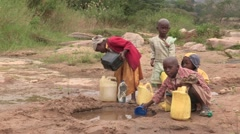 Kenya: Children Collect Water - stock footage