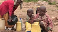 Stock Video of Kenya: Children Collect Water Stock Footage