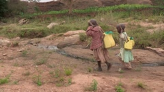 Children Walk Home with Water Stock Footage