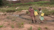 Stock Video Footage of Kenya: Children Walk Home with Water