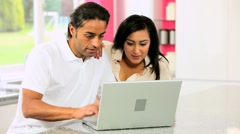 Ethnic Couple with Laptop Having Online Success Stock Footage