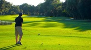Young golfer hits a drive in slow motion Stock Footage