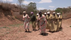 Kenya:  African Women Dance and Sing - stock footage