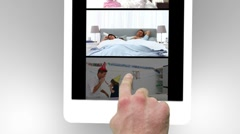 Tablet being used to watch two short party films - stock footage
