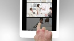 Tablet being used to watch two short conference films - stock footage