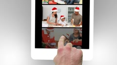 Tablet being used to watch two short christmas related family films - stock footage