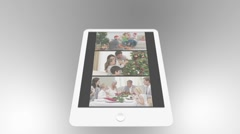 Tablet being used to watch two short christmas related family films with - stock footage