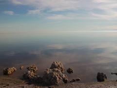 Clouds and rocks by the Salton Sea Stock Footage