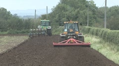 Ploughing and tilling, rear view. - stock footage