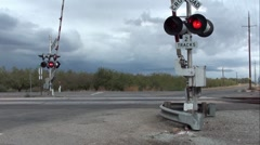 Railroad Crossing with Active Guards and Lights Flashing Stock Footage