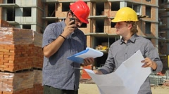 Construction workers, teamwork - stock footage