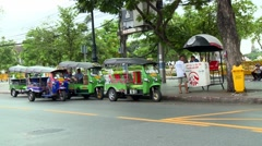 Tuk Tuk  is a motorized development of the traditional transport in Bangkok. Stock Footage