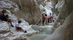 People go through narrow Saklikent canyon, Turkey Stock Footage