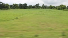 Scene from moving train, North India Stock Footage