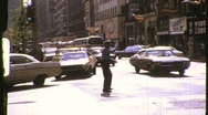 Stock Video Footage of TRAFFIC COP POLICEMAN Directs Traffic 1970s (Vintage Retro Film Home Movie) 789