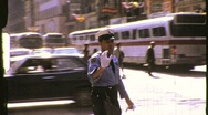 Stock Video Footage of Traffic Cop Policeman Directs Traffic Circa 1975 (Vintage Film Home Movie) 791
