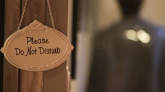 Do not disturb sign on a hotel door Stock Footage