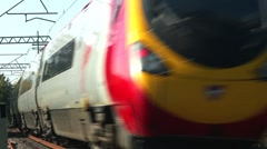 Pendolino tilting passenger train on a curve on the West Coast mainline England - stock footage